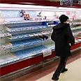 Empty shelves in Japanese supermarket following tsunami Photo: AP