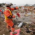 Aid worker in Miyagi Prefecture Photo: AP