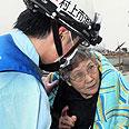 Survivor in Miyagi Prefecture Photo: AP Photo/Kahoku Shimpo via Kyodo News