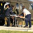Injured being evacuated following shooting incident Photo: Tomeriko
