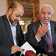 Azzam al-Ahmed and Moussa Abu Marzouk Photo: EPA