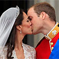 Kate and William kiss on balcony Photo: AP