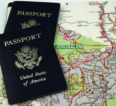 US passports on a map of Jerusalem (Photo: Shutterstock)