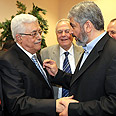 Abbas with Hamas official Mashaal Photo: AP
