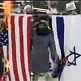 Mourners burned Israeli, American flags