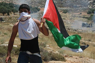 Palestinian protester on Naksa Day (Photo: EPA)