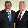 Peres (R) with Lula da Silva Photo: Amnon Meranda