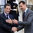 Assad with Sarkozy in Paris Photo: Reuters