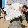 Gazan with flour provided by UNRWA Photo: AP