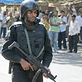 Indian security officer near Chabad center Photo: AFP
