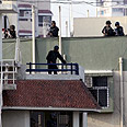 Commandos charge Chabad house Photo: AFP