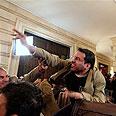 Al-Zeidi hurls Photo: AP