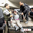 Wounded Gazan after IDF strike Photo: Reuters