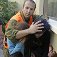 Ashkelon residents take cover during rocket attack this week Photo: Reuters