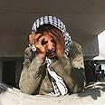 A Gazan outside Shifa Hospital Photo: AP