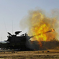 Artillery fire in Gaza Photo: Reuters