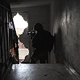 Soldier in Gaza home during offensive (archives) Photo courtesy of IDF Spokesperson Unit