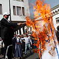 Burning Israeli flags in Rabat Photo: Reuters