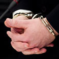Handcuffs Photo: EPA