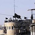 Black flags fly in Mea Shearim Photo: Shlomi Cohen