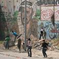 Riot in Qalandiya Photo: Gil Yohanan
