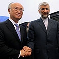 IAEA Chief Amano with Iranian negotiator Photo: AFP