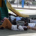 Migrants in a south Tel Aviv park Photo: Ofer Amram