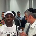 Eli Yishay with deported refugees Photo: Moti Kimchi