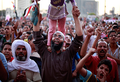 Protesters denounced army's attempt to sieze powers (Photo: Reuters)