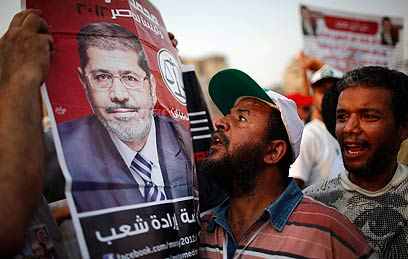 Celebrating Morsi's victory (Photo: Reuters)