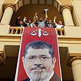 Social calamity? Morsi banner in Cairo Photo: AP