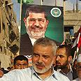 Haniyeh celebrates Morsi win Photo: AFP
