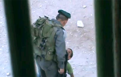 Border Guard kicks Palestinian kid in June (Photo: B'Tselem)
