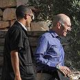אהוד אולמרט יוצא מביתו יום לאחר זיכוי Photo: Gil Yohanan