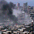 Smoke rises above Homs Photo: AFP, Shaam News Network