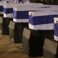 Caskets of victims arrive in Israel Photo: Ohaz Zwigenberg