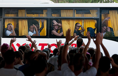 New recruits wave goodbye to families Photo: Yaron Brenner