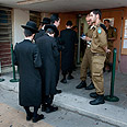 Haredim at military induction center Photo: Yaron Brenner
