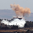 Shelling is Syria as seen from Golan Heights Photo: EPA