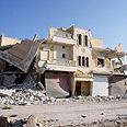 Haleb building destroyed in fighting Photo: EPA