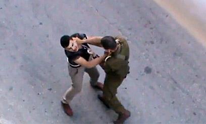 IDF officer headbutts Palestinian teen in July (Screenshot)