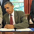 Obama, signing the bill Photo: AP