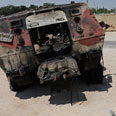 Armored personnel carrier after attack Photo: AP