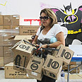 Worried. Woman in kits&#39; distribution center Photo: Moti Kimchi