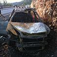 Burnt taxi Photo: Israel Police
