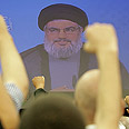 Hezbollah supporters in Nasrallah TV speech Photo: AFP