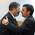 Warm welcome? Morsi and Ahmadinejad Photo: EPA