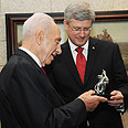 Peres and Canadian PM Harper last May Photo: Mark Neiman, GPO