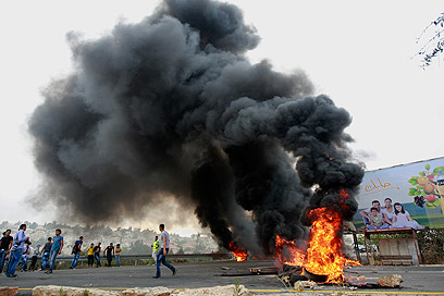 Protesters burned tires on streets (Photo: AP)
