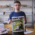 Editor with cover featuring prophet cartoon Photo: AFP